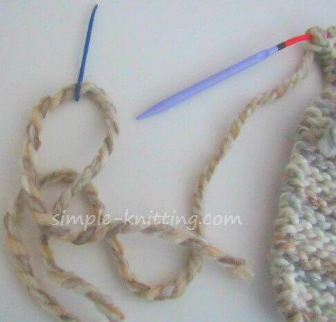 threaded yarn to finish slipper